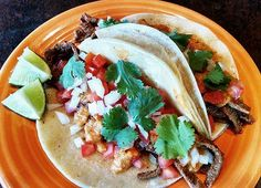 Carne Asada Tacos with grilled spicy steak, salsa roja, onion, tomato ...