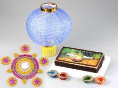 Monginis Food Pvt Ltd is the most trusted & biggest Cake brand in India since We are the largest manufacturers of Cakes, Pastries, packaged good and other baked products. Diwali Gift Hampers, Diwali Photos, Cake Branding, Diwali Gifts, Big Cakes, Diwali Decorations, Cake Shop, Online Gifts, Decorative Items