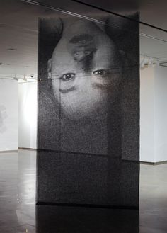 Korean-based sculptor Seung Mo Park creates giant portraits by cutting layers of mesh wire.