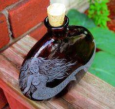 Hey, I found this really awesome Etsy listing at https://www.etsy.com/listing/152263620/mermaid-etched-on-recycled-glass-bottle