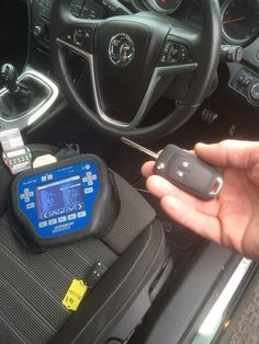 Genuine Vauxhall Astra remote key, supplied, cut to code and programmed diagnostically at Keyishoes.