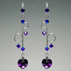 Very long bold earrings... 21ga Sterling Silver wire formed into delicate and unusual connectors supporting 4 4mm cobalt ab 2x Swarovski crystal bicones and at the bottom a 10mm Heliotrope Swarovsk...