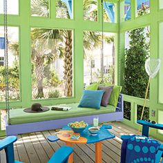 Beach-Themed Outdoor Living | Bold Porch | SouthernLiving.com  -hmmm #beach theme?!?! not a bad idea for outback   @Shannon Day...i could paint the pallets blue and green and have a huge beach type sandbox. hmmm ideas ideas