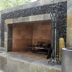 river rock and slate outdoor fireplace surround - Studio H Landscape Architecture via Atticmag Slate Fireplace, Outdoor Fireplace Designs, Fireplace Hearth, Fireplace Surrounds, Outdoor Fireplaces, Fireplace Ideas, Fireplace Facade, River Rock Fireplaces, Marble Fireplaces