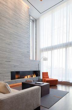 Sleek modern stone fireplace