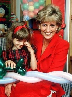 Princess Diana holding the child of an HIV patient at the London Lighthouse, a centre for people affected by HIV and AIDS, in London, October 1996.