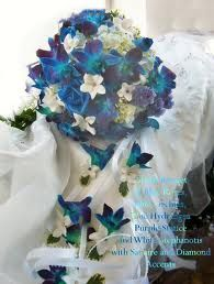 Bridal bouquet blue orchids, add in some yellow flowers too. Oh of course they're orchids.. dang expensive taste! Lol.