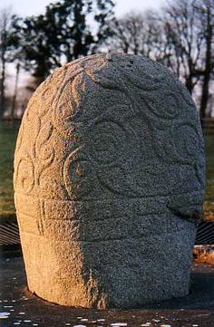 Decorated with curvilinear designs of the Celtic style La Tene, and encircle with a Greek key pattern, the Turoe stone dates to sometime in the 1st to 3rd centuries BC (Co. Galway, Ireland)
