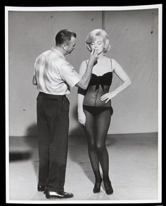 "Allan ""Whitey"" Snyder applying Marilyn Monroe's makeup on the set of ""Lets Make Love"""