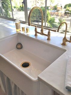 Detail of farm sink and unlaquered brass kitchen faucet/Patina Farm/Brooke Giannetti Corner Sink Kitchen, Kitchen Sink Design, Kitchen Sink Faucets, Brushed Brass Kitchen Faucet, Brass Faucet, Island Kitchen, Kitchen Counters, Kitchen Fixtures, Plumbing Fixtures