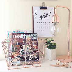 I adore this. I'd design the calendar myself, have a cactus in the little plant pot and house my makeup books/ magazines in the little basket. Adore the rose gold theme in the office. <3
