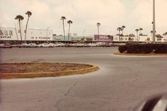 "A wide view of the Midway Shopping Center in Largo, Florida, showing part of a Publix store (once again minus the ""Market"" and plus the ""swagger"") among some hard-to-identify fellow tenants. One that's not hard to identify is Cloth World, the ""Wonder World of Fabric"", a chain that was bought out by Jo-Ann Fabrics in 1994."