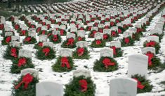 tomb of the unknown in the winter time | Christmaswreaths adorn head stones at Arlington National Cemetery. The ...