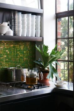 Green and gold tile backsplash. Handmade tiles can be colour coordinated and customized re. shape, texture, pattern, etc. by ceramic design studios