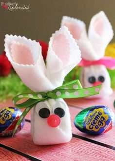 An easy Easter craft idea for how to make Cadbury Creme Egg bunnies with felt, wiggle eyes, a button, ribbon and hot glue.