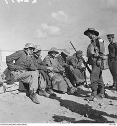 German DAK prisoners captured in the Western Desert, guarded by an Australian digger, March Afrika Corps, Australian Desert, Erwin Rommel, German Helmet, Italian Army, Free In French, Nuclear War, Anzac Day, Army & Navy