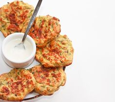 Baked Zucchini Fritters  2 large zucchini, grated  1 small red onion, grated  1/2 cup whole wheat flour  1/2 teaspoon salt  1/4 teaspoon pepper  a splash of milk  1 egg