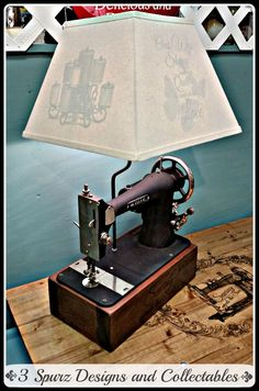 3 Spurz D&C Repurposed /Refurbished Creations!!: White # 8 sewing machine lamp with custom lamp shade with images on all 4 sides. Follow us for more wonderful pins at http://pinterest.com/3spurzdandc/... http://facebook.com/... http://www.3spurzdesignsandcollectables.com/about-us