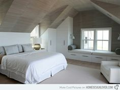White walls, darker ceiling, bench by the window