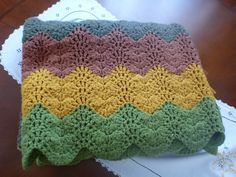 A personal favorite from my Etsy shop https://www.etsy.com/listing/153392767/vintage-earth-tone-afghan-throw-blanket
