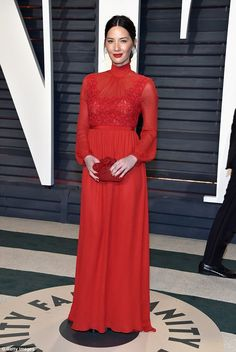 Lady in red! Oliva Munn stunned in a floor-length scarlet gown at the Vanity Fair Oscars Party on Sunday night