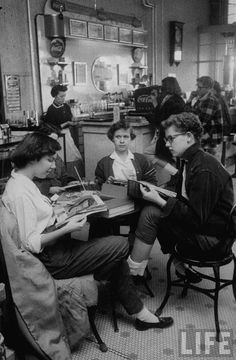 Teenage girls drinking soda in a drugstore. Lebanon, Kansas, 1957.  By Francis Miller