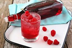 Homemade Raspberry Liqueur - When sweet fresh raspberries are overflowing in the summer, create this delicious cordial that is fabulous on it's own or a perfect way to brighten up any cocktail.
