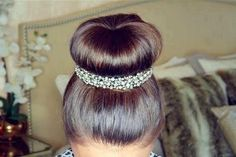 sock bun encircled by necklace or hair jewelry
