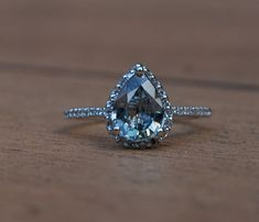 Stunning pear sapphire diamond ring 14k white gold; this one is my dream <3 maybe a plain silver band though...
