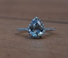 blue sapphire pear shape diamond ring