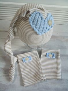 Darling newborn photography baby boy prop set hat legwarmers beige and blue with heart. $23.00, via Etsy.