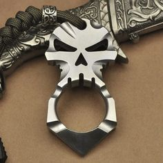 Titanium Ti Ferocious Skull Cross Skeleton Design Pendant Keychain Self Defense Camping Survival Tool. Material: Titanium Ti Alloy (Gr5) Size: 74.5mm (Length) x 38.5mm (Width) x 10mm (Thickness) Double-Sided Sculpture Net Weight: 50g Predominant Color #756F62Price 57View on Amazon.com
