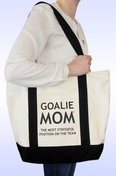 Goalie Mom® Cotton Canvas Tote Bag. This tote is great for carrying your belongings to game! Perfect for soccer goalie moms, hockey goalie moms and more.