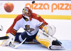 Florida Panthers goalie Roberto Luongo makes a save on Toronto Maple Leafs' Tyler Bozak during the second period of an NHL hockey game Thursday, March 26, 2015, in Toronto. (AP Photo/The Canadian Press, Frank Gunn)
