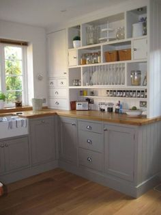 Great Use Storage Space Idea To Organize Small Kitchen..paint the cabinets, get these counters and knobs and do the storage center on the wall with no cabinets,,,YES