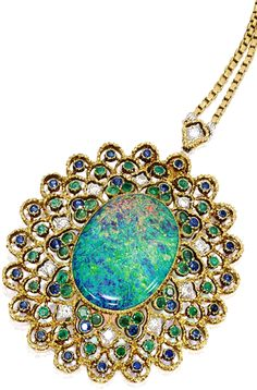 OPAL, COLOURED STONE AND DIAMOND PENDANT NECKLACE, BUCCELLATI The pendant of openwork design, centring on an opal weighing approximately 11.00 carats, decorated by circular-cut diamonds, emeralds and sapphires, mounted in 18 karat yellow gold, completed by a gold link-chain, length approximately 400mm, pendant detachable, with brooch fitting, signed.