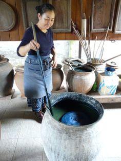 Stirring the indigo vat in Laos