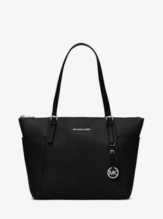 Jet setters, take note: this sophisticated tote is the ultimate travel companion. Crafted from our signature Saffiano leather, it sports a look that's chic yet understated. A multitude of pockets keeps you organized, while the top-zip design ensures your essentials stay put, wherever you may go.