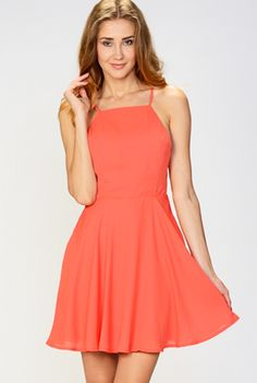 MOON COLLECTION 'Room With A View' Dress - A simple but stunning fit and flare halter style dress with an amazing back view! This pretty coral dress has a high neck line with a spaghetti strap criss cross detail in the back. The skirt has a back zip closure and reaches mid-thigh. Available in Coral. 100% Polyester. Imported. By Moon Collection.