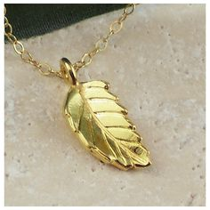 Leaf Necklace Celebrity Style Single Gold Charm Handmade Winter Fashion ($30) found on Polyvore featuring women's fashion, jewelry, necklaces, gold filled necklace, gold chain necklace, 14 karat gold necklace, charm necklace and gold charms