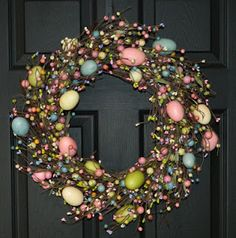 Easter DIY Wreath . . .    Add ribbon bows, silk tulips, hydrangea, easter lilies & greenery.    Place this in the center as focal point:    http://www.orientaltrading.com/laser-cut-crosses-a2-92_653.fltr?prodCatId=90000+1232+1967