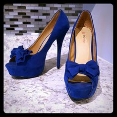 Beautiful New Lita Pumps from JustFab Cobalt blue faux-suede peep toe pumps with an adorable bow! These have only been tried on, and then they sat in my closet. I found these to be true to size. 6 inch heel with 1.5 inch platform. Comfortable! JustFab Shoes Heels
