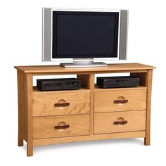Our handmade natural cherry Berkeley 4 drawer dresser and TV stand has an American Craftsman style fused with modern Asian design.