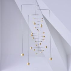 Hanging Mobile Gallery specializes in decorative hanging art including kinetic mobiles by top mobile designers for home and nursery decor. Mobile Art, Cheap Mobile, Hanging Mobile, Hanging Art, Mobile Sculpture, Origami And Quilling, Coin Display, Wood Colors, Nursery Decor