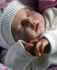 Reborn doll...Anna... Sleeping reborns remind me of my own babies in those rare times when they finally slept...I could kiss them and get some work done!