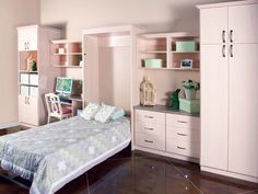 Wallbeds - Classic Maple Twin-Size Down.  Add your choice of cabinets, choose your size, design, wood finish and accessories.  Start utilizing your space today!  http://organizingutah.com/content/pages/wall_beds/