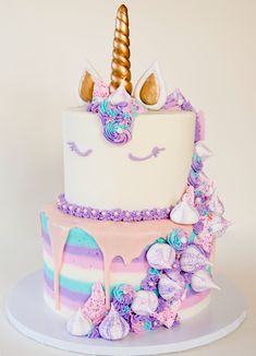 @jackiecellabakes Two tier unicorn cake with buttercream, meringues, unicorn bark. Magical!!!