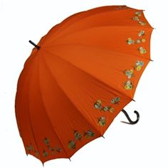 UV Umbrella Kyoto Poppies - Mandarin; Regular Price: $96.00  On Sale For: $79.00  Poppies - Mandarin  The mandarin orange canopy of this asian-inspired parasol has a hidden super power - not only is it waterproof, it is also blocks harmful UV rays with a clear fabric coating!  You'll be safe from rain, sun, and the blues with its fun poppy embroidery around the 16-rib canopy's edges.  The additional ribs not only add to its elegance, they lend strength in the wind.  Matte black curved…