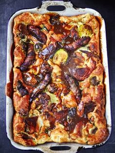 Toad in the hole--Yorkshire pudding filled with leftovers & dirty gravy (Jamie Oliver) Toad In The Hole, Leftovers Recipes, Leftover Sausage Recipes, Leftover Turkey, Tortellini, Hamburger, Cooking, Christmas Recipes, Pork