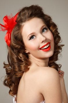 Sweet Curly Pin Up Hairstyle with Red Bow